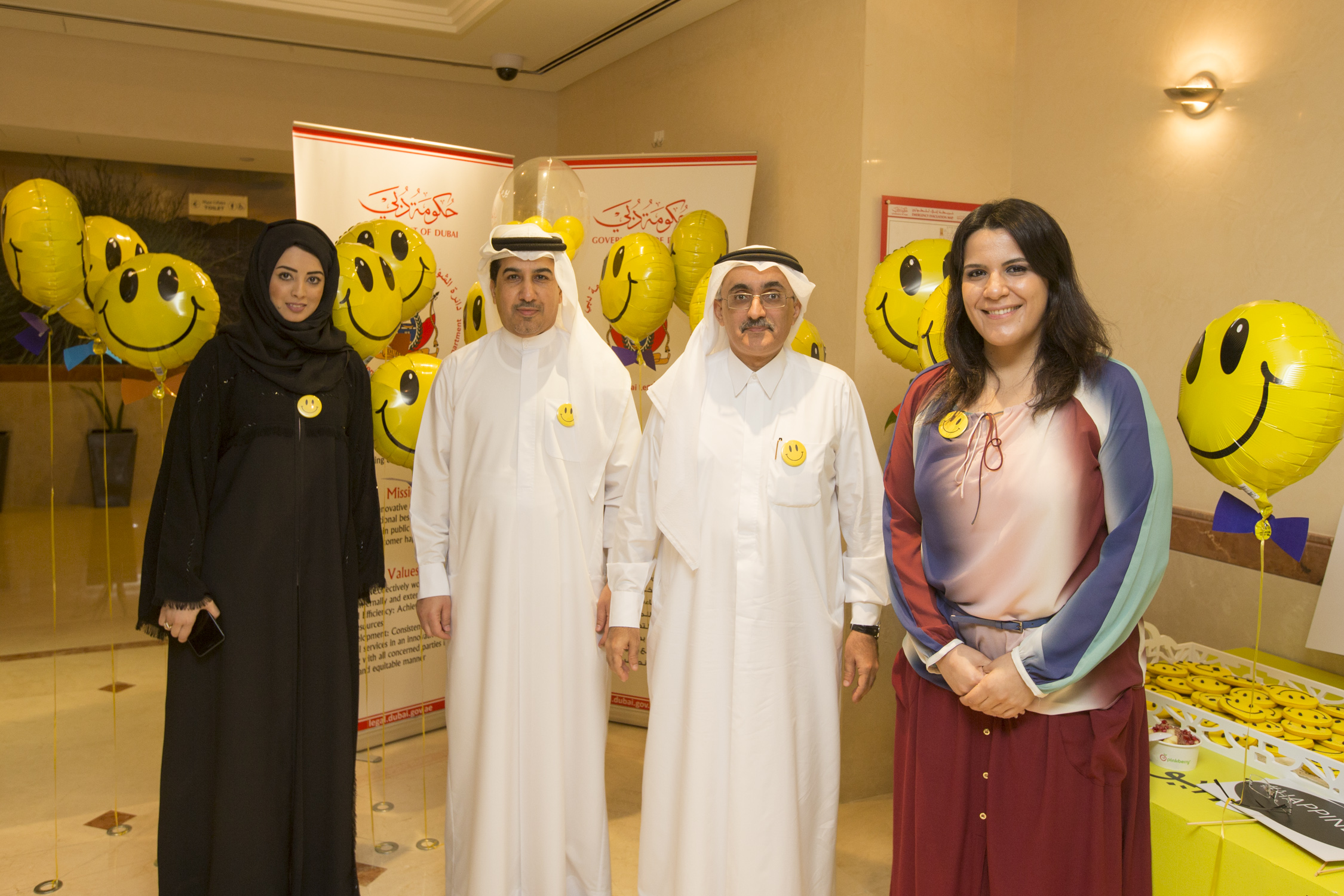 "The Government of Dubai Legal Affairs Department Celebrates the International Day of Happiness and Distributed ""Perceptions in Happiness and Positivity"" Book to its Employees.-Monday-20/03/2017"