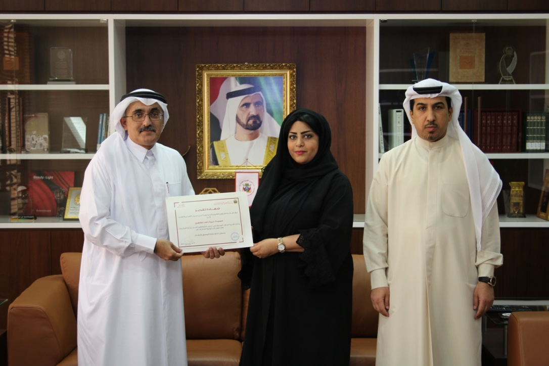 The Director General Dr.Lowai Belhoul honors Miss. Amina Rashid Al Dhaheri in recognition of her distinguished effort for training the new joiners in the Government Disputes & Claims Directorate at The Government of Dubai Legal Affairs Department in pres